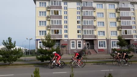 dom : Sochi, Russia - June 5. 2018. bicycle racers train around hotel Barchatnye Sezony and Russky Dom