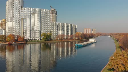 Khimki, Russia - October 17. 2018. cargo ship Volgo-Don sailing along Moscow Canal near residential complex Mayak