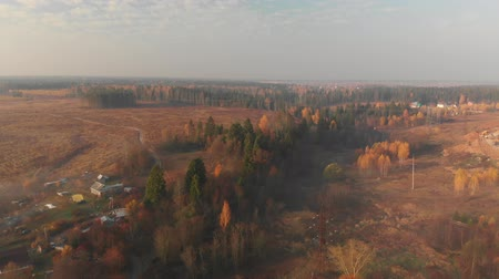 rural area : Flying over countryside on a foggy morning in Russia Stock Footage