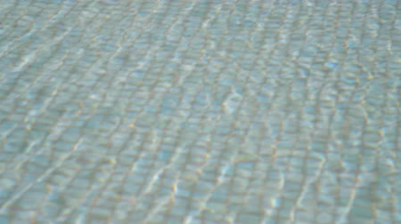 chaise longue : Small waves on the surface of the water in the pool Stock Footage