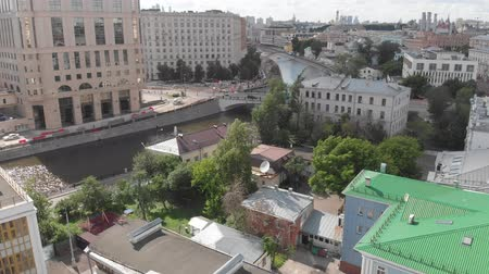 bridgework : Top view of old houses in center and the Vodootvodnyy channel in Moscow, Russia.