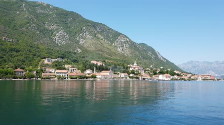 maria : View of Prcanj city and Church of the Virgin Mary, Montenegro Filmati Stock