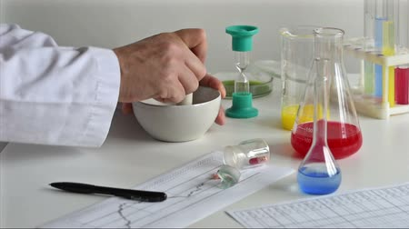 образец : man holding experiments in a chemistry lab