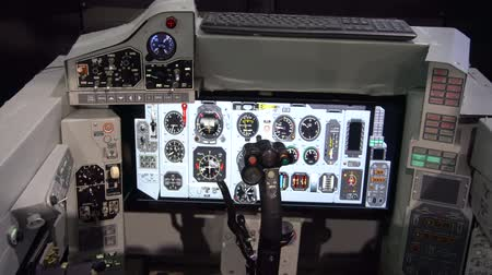 cabins : BELARUS, MINSK, 17 May 2019: 9th International Exhibition of Armament and Military Equipment Milex -2019. Aviation simulator for military aircraft pilot at an exhibition of military equipment and weapons Stock Footage
