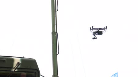 BELARUS, MINSK, 17 May 2019: 9th International Exhibition of Armament and Military Equipment Milex -2019. Drone flies over Radio-electronic warfare for exposure to radio emission on radio-electronic means of control systems at the exhibition of military e