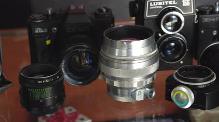 retro revival : Belarus, Soligorsk, July 1, 2019: many old variety of Soviet film analog retro cameras and lenses close-up in photo studio or museum close-up