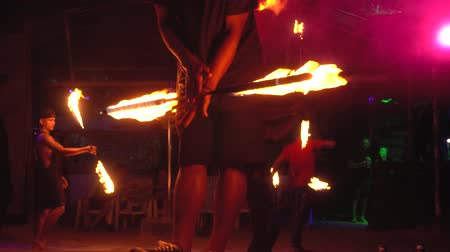 Thailand, Phi Phi Island, September 28, 2019: Fire show on open beach. burning staff pole man twists in arms