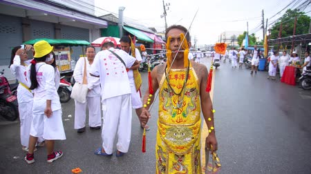 Thailand, Phuket, October 7, 2019: Thai man of Chinese descent with a pierced cheek and tongue pierced by many metal knitting needles at the annual Phuket vegetarian festival Stok Video