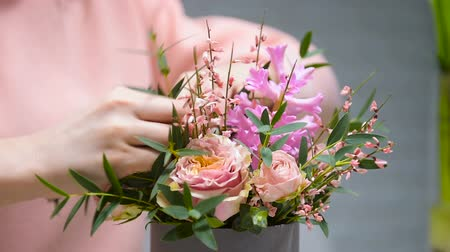 Female hands making beauitful bouquet
