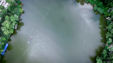 An aerial view of four crew rowers in a boat