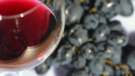 Camera spin around glass of wine and grapes
