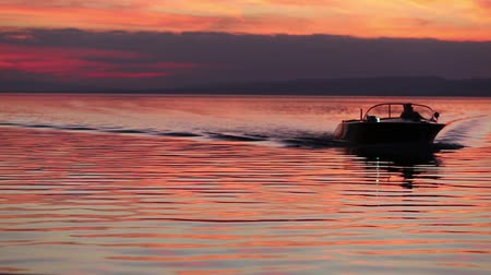 lancha : motorboat approaching the camera at sunset in silhouette
