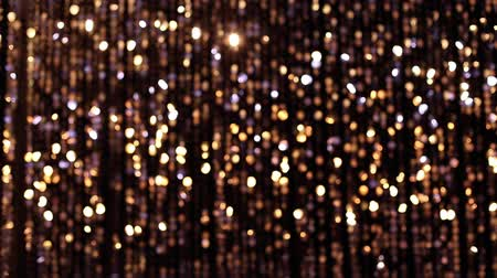 doted : Abstract glittering light gold background, a real shot in the video blur