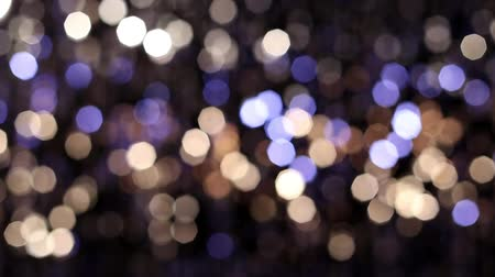 doted : Abstract glittering lights, silver background, a real shot in the video blur