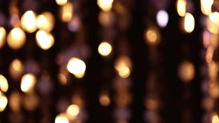 doted : Abstract glittering lights, gold background, a real shot video in the blur, detail