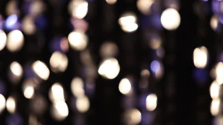 doted : Abstract glittering lights, silver background, a real shot video in the blur, detail