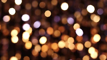 doted : Abstract glittering lights, gold background, a real shot video in the blur Stock Footage