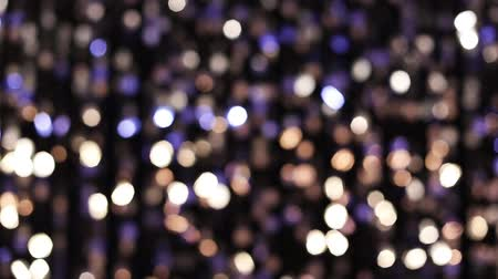 doted : Abstract glittering lights, silver background, a real shot video in the blur