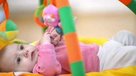 toy : Innocent baby smiling and playing with toys Stock Footage