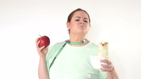нездоровое питание : Corpulent woman struggle to eat healthy. Choosing healthy food.