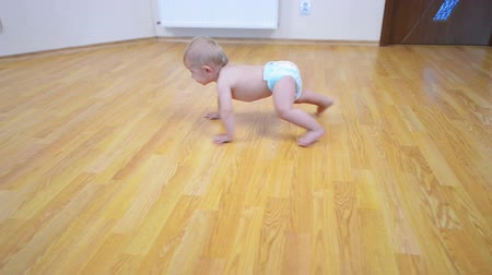 home life : Happy baby go on all fours on the floor at home
