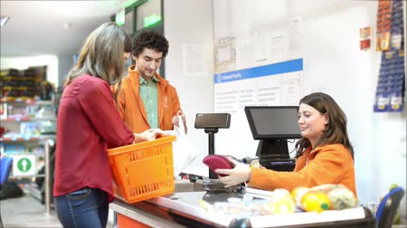 Customer at checkout in a market