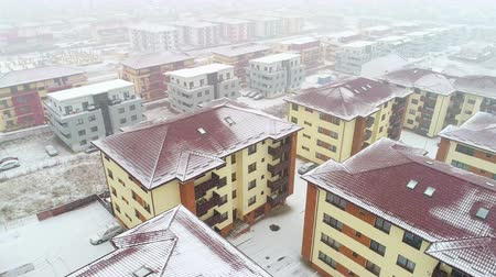 Aerial view of residential area, snowing, winter time Stok Video