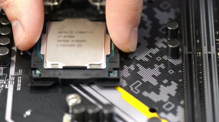 Installing central procesor unit on pc mainboard, close up view Stok Video