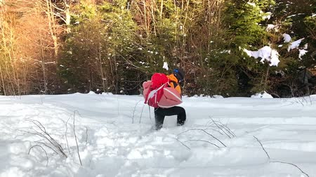 Mountaineer testing an avalanche protection backpack with airbags pyrotechnic system