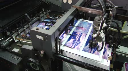 printings : Pages being fed into a two colour offset printing press Stock Footage