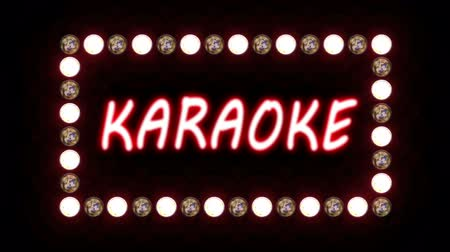 karaoke : Karaoke neon sign surrounded by flashing lights on a black background. Looping video, contains alpha mask