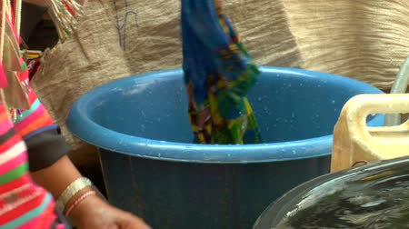 hill tribe : Akha hill tribe women doing laundry by hand Stock Footage