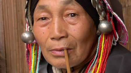 trubka : Old Akha woman smoking a pipe