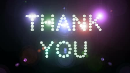 sayesinde : ?Thank You? sign surrounded by flashing lights on a black background. Looping video, contains alpha mask