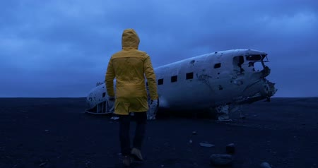 wanderlust : Man at the Solheimasandur plane wreck, Iceland Stock Footage