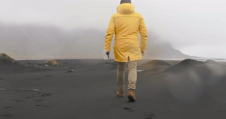 Man walking in Vesturhorn, Iceland