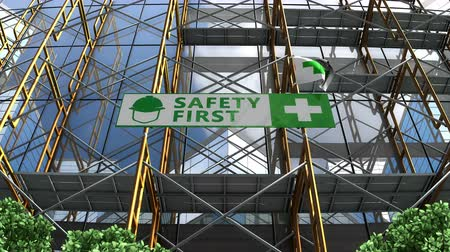 signboard : Building under construction, scaffolding and Safety First signboard.