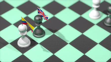 negotiations : Chess Pawn with country flag, Ecuador, United Kingdom. Stock Footage