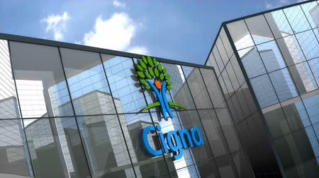 лечение зубов : May 2019, Editorial use only, 3D animation, Cigna logo on glass building.