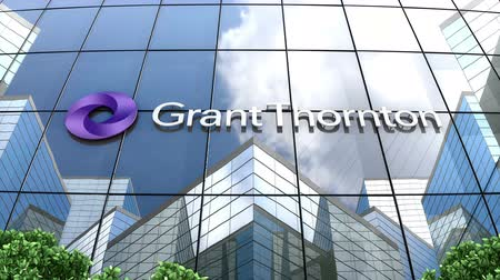 belasting : May 2019, Editorial use only, 3D animation, Grant Thornton logo on glass building. Stockvideo