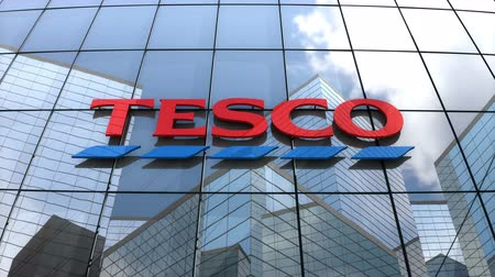 retailing : April 2018, Editorial use only, 3D animation, Tesco plc logo on glass building.