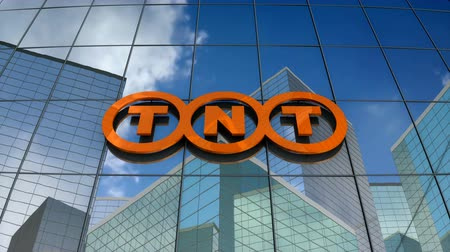 курьер : March 2018, Editorial use only, 3D animation, TNT Express logo on glass building.