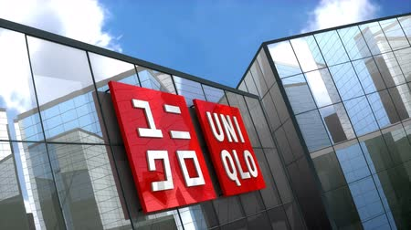 только : June 2018, Editorial use only, 3D animation, Uniqlo Co., Ltd. logo on glass building. Стоковые видеозаписи