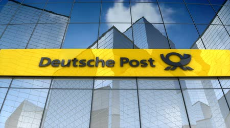 kézbesítés : December 2017, Editorial use only, 3D animation, Deutsche Post AG logo on glass building.