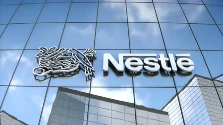 Editorial use only, 3D animation, Nestle logo on glass building. Стоковые видеозаписи
