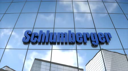Editorial use only, 3D animation, Schlumberger logo on glass building. Stok Video