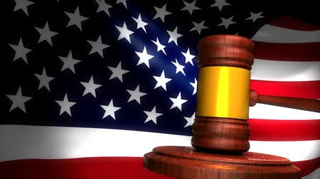 jurisdiction : Gavel with american flag background. Stock Footage