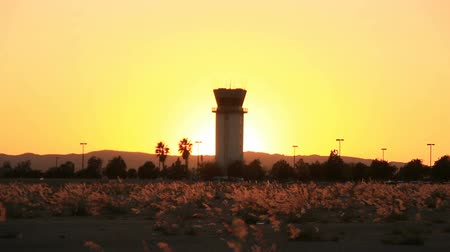 Time lapse of sunset behind airport tower at Hollywood Burbank Airport Stock mozgókép