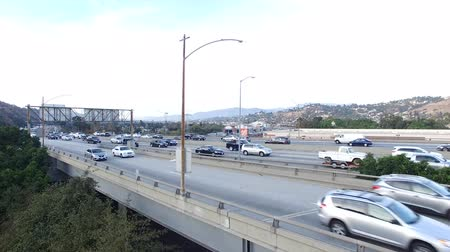 Aerial pedestal reveal of freeway traffic in Los Angeles, CA