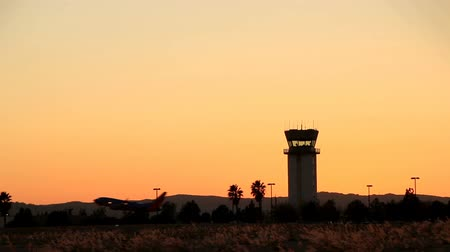 Small airport runway at sunset at Hollywood Burbank Airport Stock mozgókép